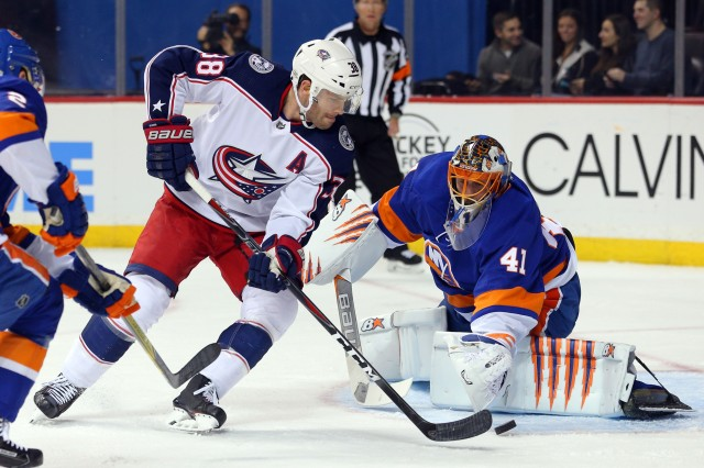 Feb 3, 2018; Brooklyn, NY, USA; New York Islanders goalie Jaroslav Halak (41) makes a save against Columbus Blue Jackets center Boone Jenner (38) during the first period at Barclays Center. Mandatory Credit: Brad Penner-USA TODAY Sports