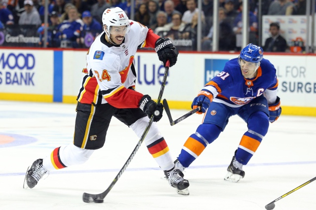 Feb 11, 2018; Brooklyn, NY, USA; Calgary Flames defenseman Travis Hamonic (24) takes a shot against New York Islanders center John Tavares (91) during the third period at Barclays Center. Mandatory Credit: Brad Penner-USA TODAY Sports