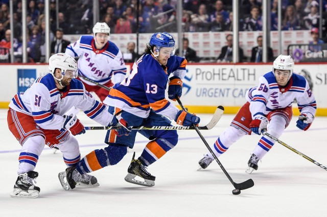 Feb 15, 2018; Brooklyn, NY, USA; New York Islanders center Mathew Barzal (13) brings the puck into the zone defended by New York Rangers center David Desharnais (51) and defenseman John Gilmour (58) during the second period at Barclays Center. Mandatory Credit: Dennis Schneidler-USA TODAY Sports
