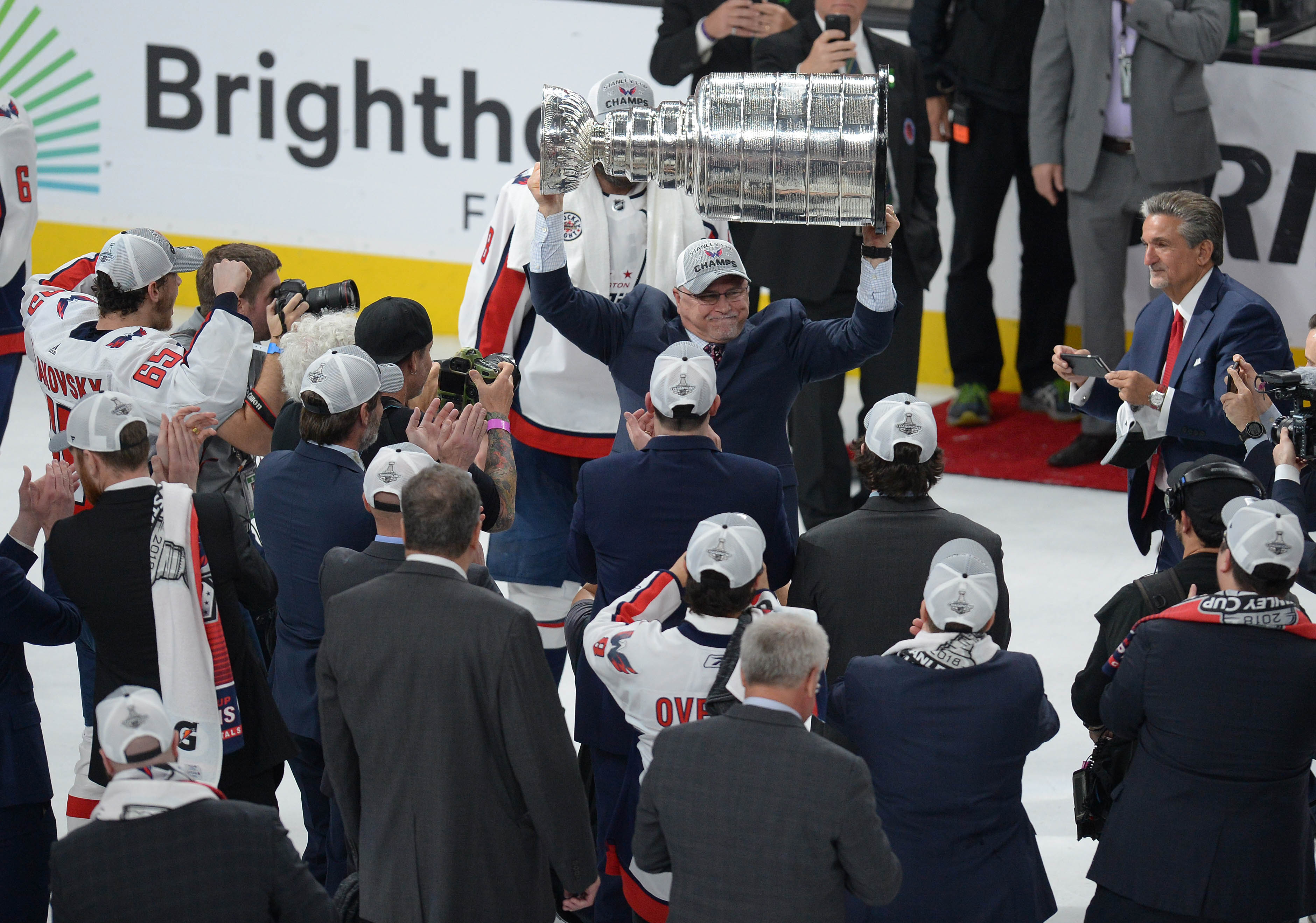 June 7, 2018; Las Vegas, NV, USA; Washington Capitals Barry Trotz lifts the Stanley Cup following game five of the 2018 Stanley Cup Final at T-Mobile Arena. Mandatory Credit: Gary A. Vasquez-USA TODAY Sports
