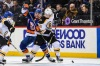 Jan 18, 2018; Brooklyn, NY, USA; New York Islanders left wing Michael Dal Colle (71) and Boston Bruins center Noel Acciari (55) battle for the puck during the second period at Barclays Center. Mandatory Credit: Dennis Schneidler-USA TODAY Sports