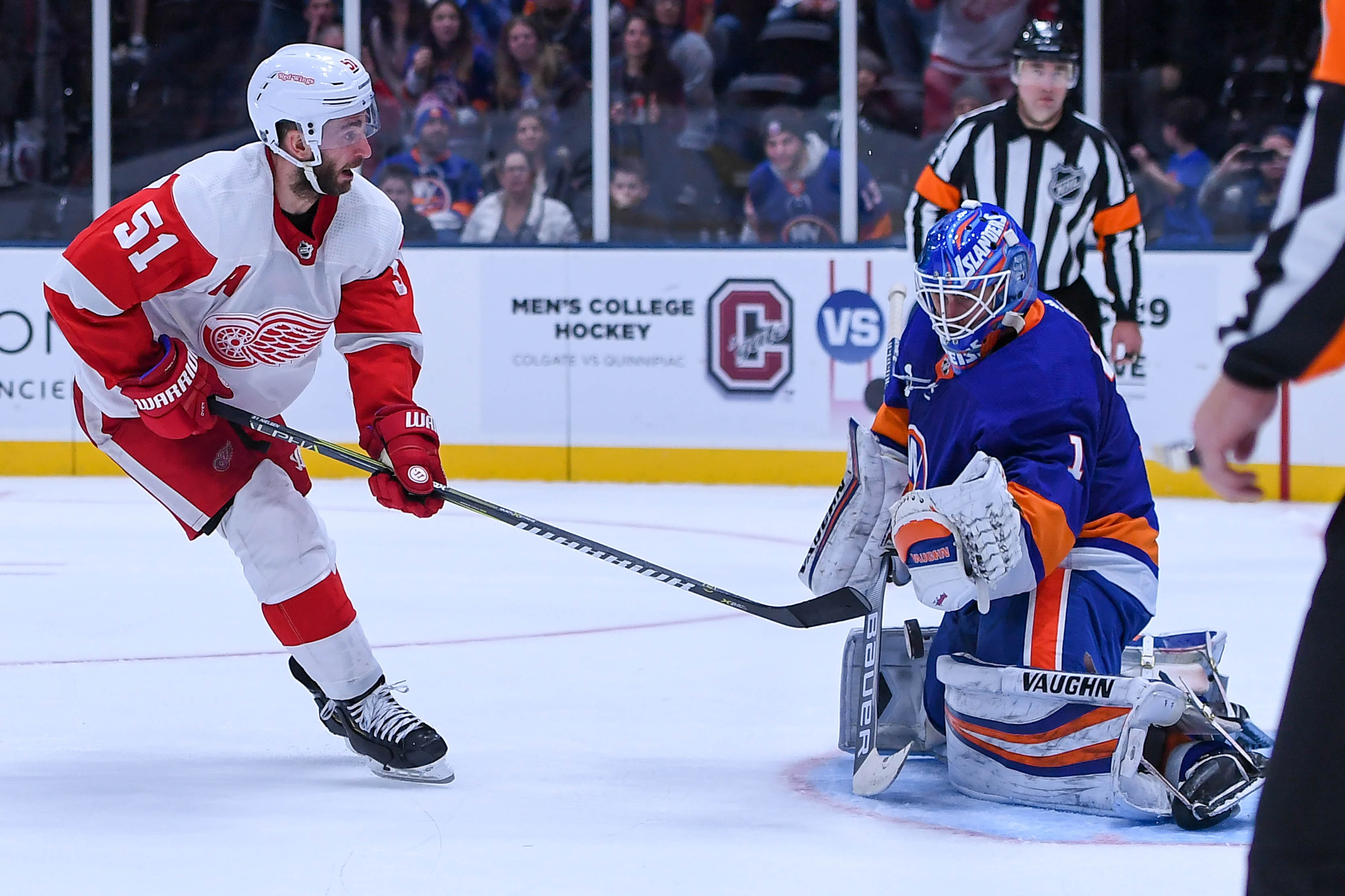 Dec 15, 2018; Uniondale, NY, USA; New York Islanders goaltender Thomas Greiss (1) makes a save on Detroit Red Wings center Frans Nielsen (51) during shootouts at Nassau Veterans Memorial Coliseum. Mandatory Credit: Dennis Schneidler-USA TODAY Sports