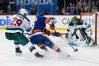 Feb 10, 2019; Brooklyn, NY, USA; New York Islanders left wing Anthony Beauvillier (18) skates with the puck around Minnesota Wild defenseman Greg Pateryn (29) as Wild goaltender Devan Dubnyk (40) defends during the second period at Barclays Center. Mandatory Credit: Dennis Schneidler-USA TODAY Sports