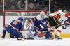 Feb 26, 2019; Uniondale, NY, USA; Calgary Flames left wing Matthew Tkachuk (19) scores a goal against New York Islanders goalie Robin Lehner (40) during the second period at Nassau Veterans Memorial Coliseum. Mandatory Credit: Brad Penner-USA TODAY Sports