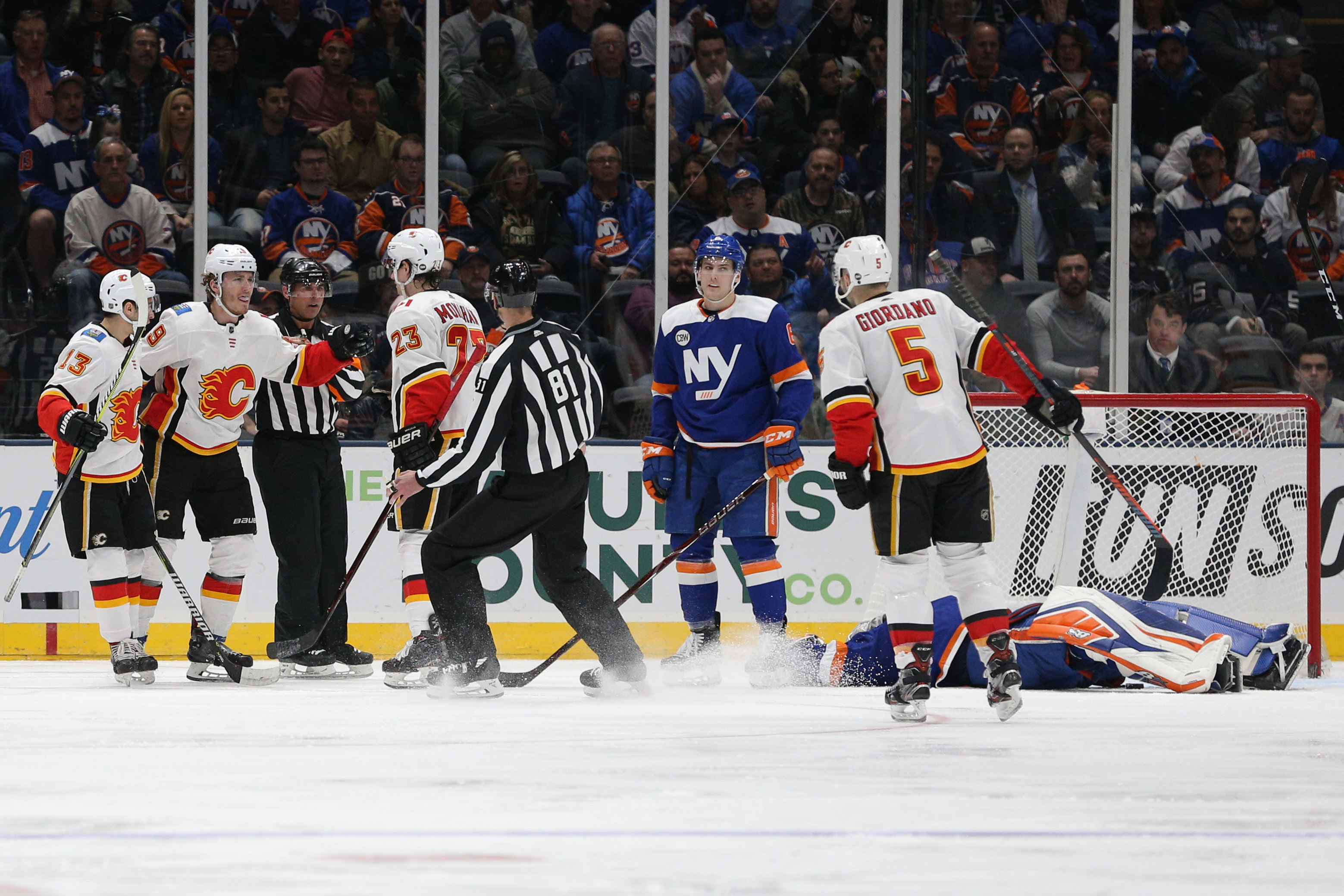 Feb 26, 2019; Uniondale, NY, USA; Calgary Flames left wing Matthew Tkachuk (19) celebrates after scoring a goal against New York Islanders goalie Robin Lehner (40) during the second period at Nassau Veterans Memorial Coliseum. Mandatory Credit: Brad Penner-USA TODAY Sports
