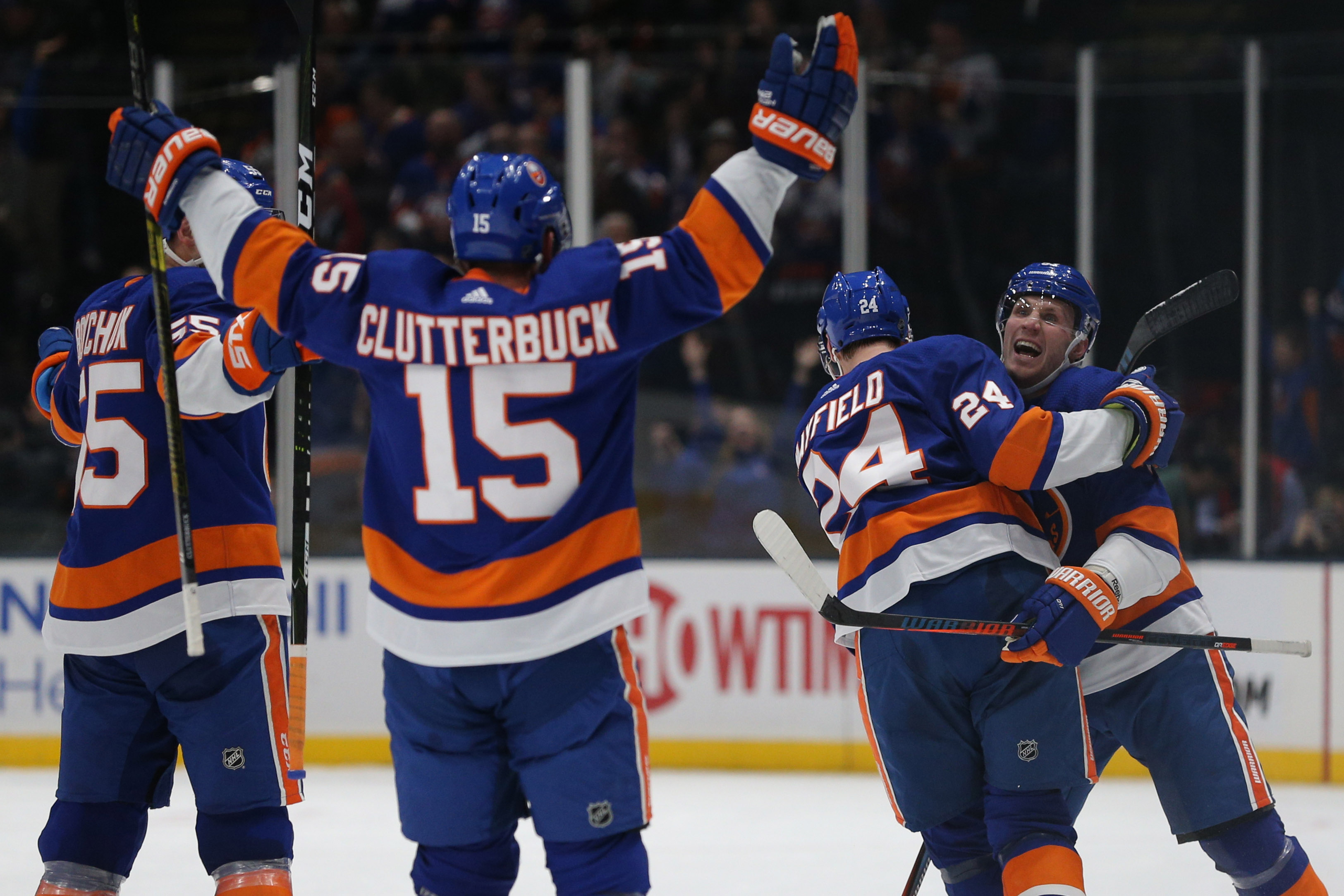 Feb 28, 2019; Brooklyn, NY, USA; New York Islanders center Casey Cizikas (53) celebrates his goal against the Toronto Maple Leafs with defenseman Johnny Boychuk (55) and right wing Cal Clutterbuck (15) and defenseman Scott Mayfield (24) during the second period at the Nassau Veterans Memorial Coliseum. Mandatory Credit: Brad Penner-USA TODAY Sports