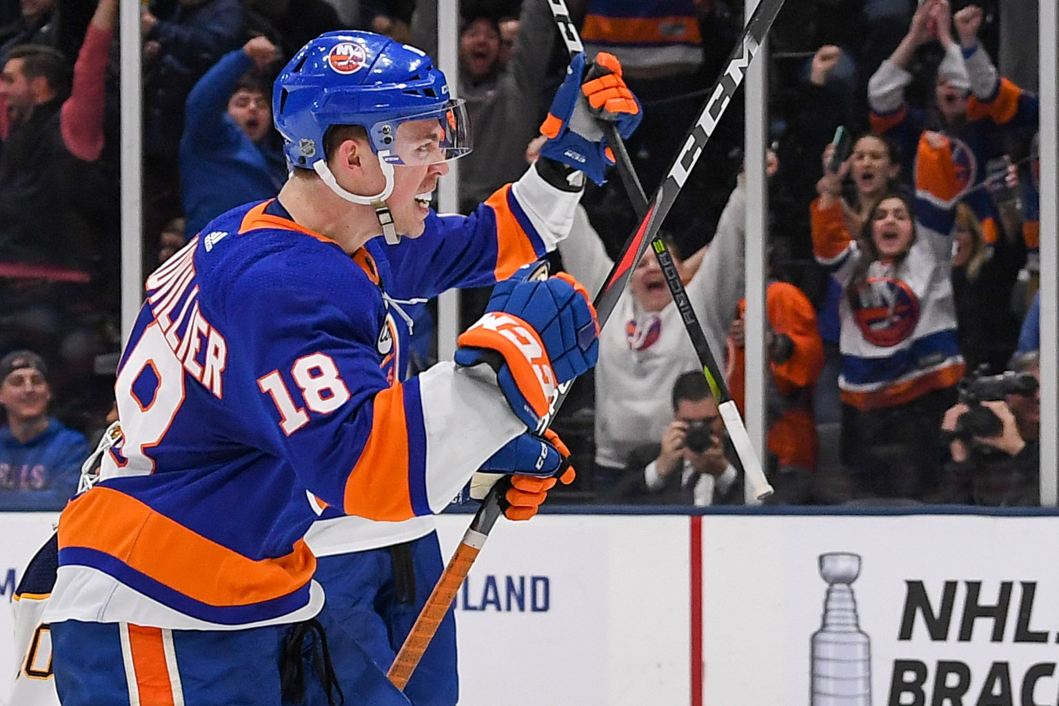Mar 30, 2019; Uniondale, NY, USA; New York Islanders left wing Anthony Beauvillier (18) celebrates his goal against the Buffalo Sabres during the second period at Nassau Veterans Memorial Coliseum. Mandatory Credit: Dennis Schneidler-USA TODAY Sports