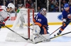 Oct 4, 2019; Uniondale, NY, USA; New York Islanders goaltender Semyon Varlamov (40) makes a save on an attempted wrap around by Washington Capitals center Chandler Stephenson (18) during the third period at Nassau Veterans Memorial Coliseum. Mandatory Credit: Dennis Schneidler-USA TODAY Sports