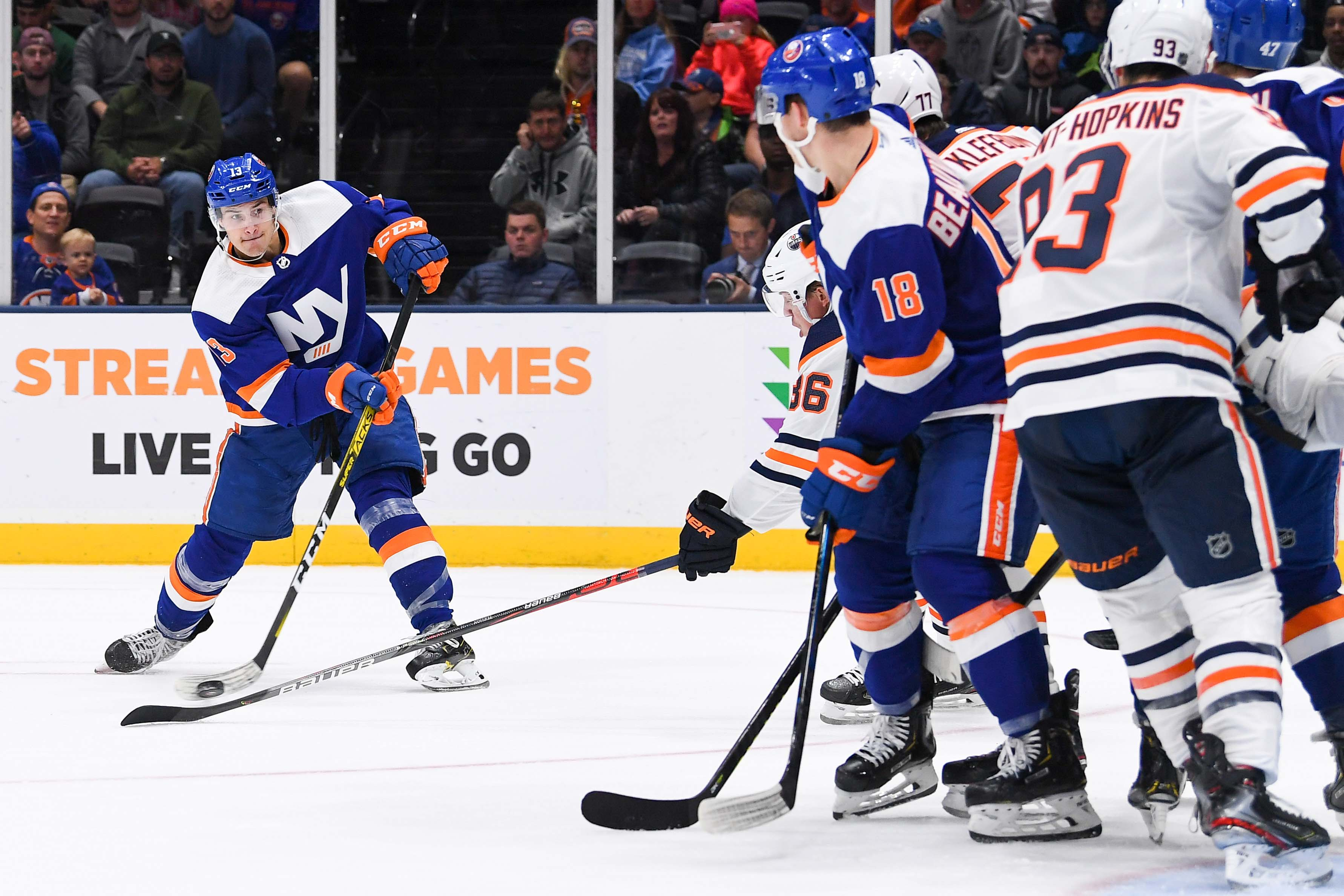 Oct 8, 2019; Uniondale, NY, USA; New York Islanders center Mathew Barzal (13) attempts a shot against the Edmonton Oilers during the second period at Nassau Veterans Memorial Coliseum. Mandatory Credit: Dennis Schneidler-USA TODAY Sports