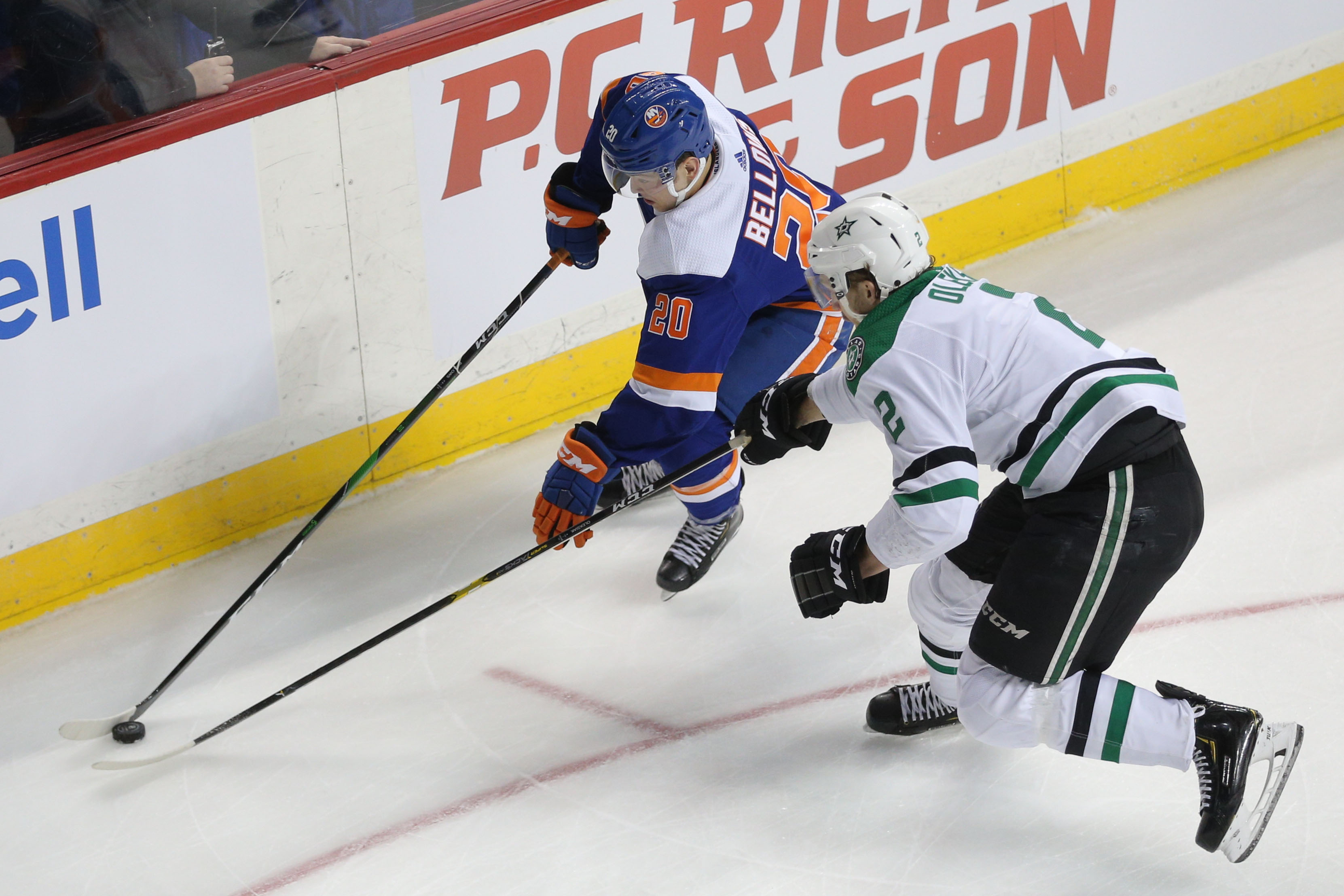 Feb 4, 2020; Brooklyn, New York, USA; New York Islanders left wing Kieffer Bellows (20) plays the puck against Dallas Stars defenseman Jamie Oleksiak (2) during the second period at Barclays Center. Mandatory Credit: Brad Penner-USA TODAY Sports