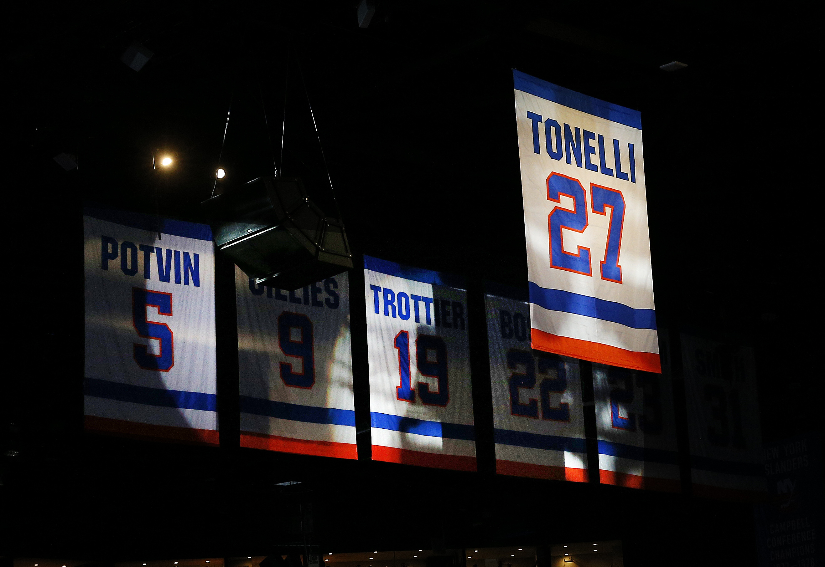 Feb 21, 2020; Uniondale, New York, USA; The number 27 jersey of New York Islanders former player John Tonelli is lifted to the rafters during a retirement ceremony prior to a game against the Detroit Red Wings at Nassau Veterans Memorial Coliseum. Mandatory Credit: Andy Marlin-USA TODAY Sports