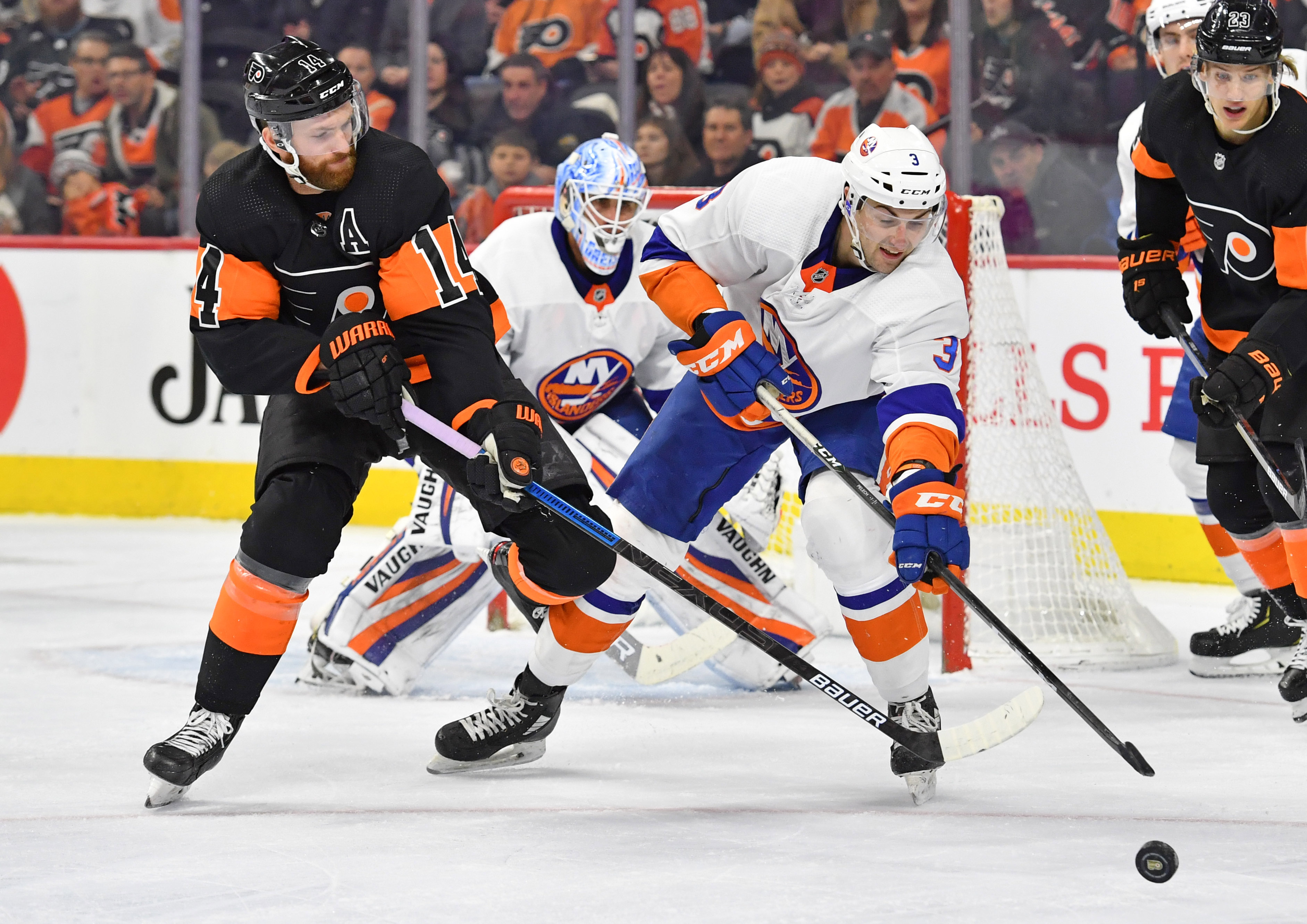Nov 16, 2019; Philadelphia, PA, USA; New York Islanders defenseman Adam Pelech (3) clears the puck away from Philadelphia Flyers center Sean Couturier (14) during the second period at Wells Fargo Center. Mandatory Credit: Eric Hartline-USA TODAY Sports