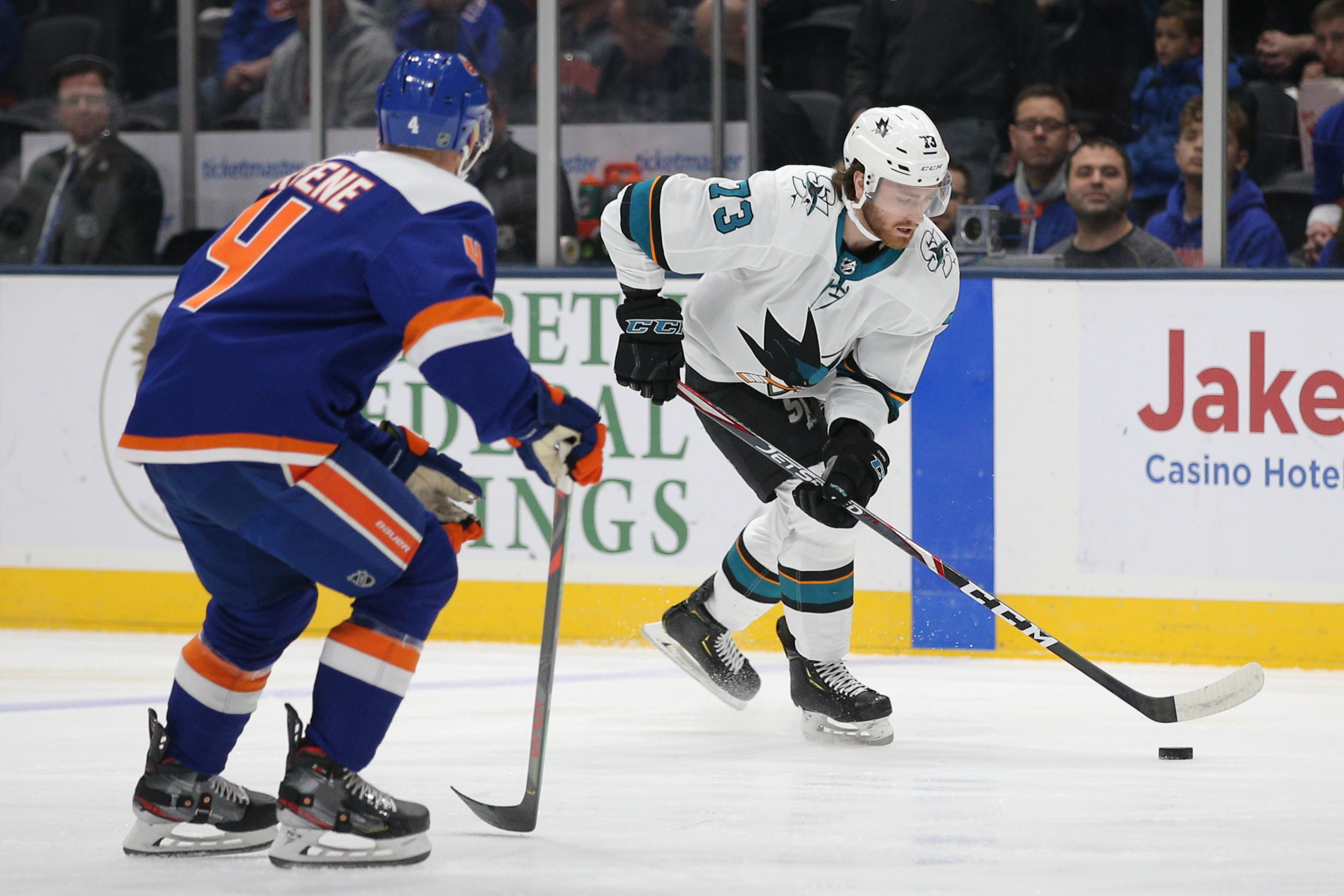 Feb 23, 2020; Uniondale, New York, USA; San Jose Sharks center Noah Gregor (73) plays the puck against New York Islanders defenseman Andy Greene (4) during the first period at Nassau Veterans Memorial Coliseum. Mandatory Credit: Brad Penner-USA TODAY Sports