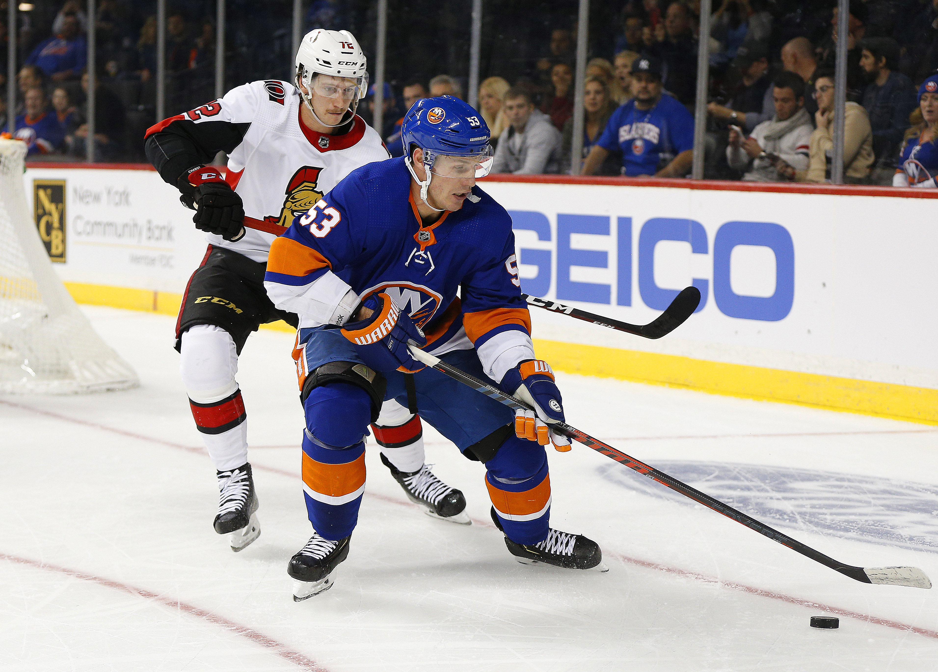 Nov 5, 2019; Brooklyn, NY, USA; New York Islanders center Casey Cizikas (53) plays the puck while being defended by Ottawa Senators defenseman Thomas Chabot (72) during the second period at Barclays Center. Mandatory Credit: Andy Marlin-USA TODAY Sports
