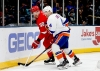 Feb 21, 2020; Uniondale, New York, USA; Detroit Red Wings right wing Anthony Mantha (39) and New York Islanders defenseman Andy Greene (4) battle for a loose puck during the first period at Nassau Veterans Memorial Coliseum. Mandatory Credit: Andy Marlin-USA TODAY Sports