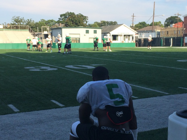 Running back Kendall Bussey looks on as Newman's punt team practices. Bussey and senior quarterback Jabiari Tyler are looking to lead the Greenies farther than the Division III regional round, where they lost 28-26 to Opelousas Catholic in 2013. (Photo by Sean McGoey/WWLTV.com)