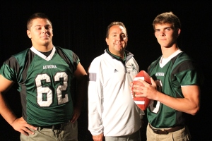 Aurora football coach Bob Mihalik poses with two of the team's leaders during WKYC-TV Channel 3's football media day
