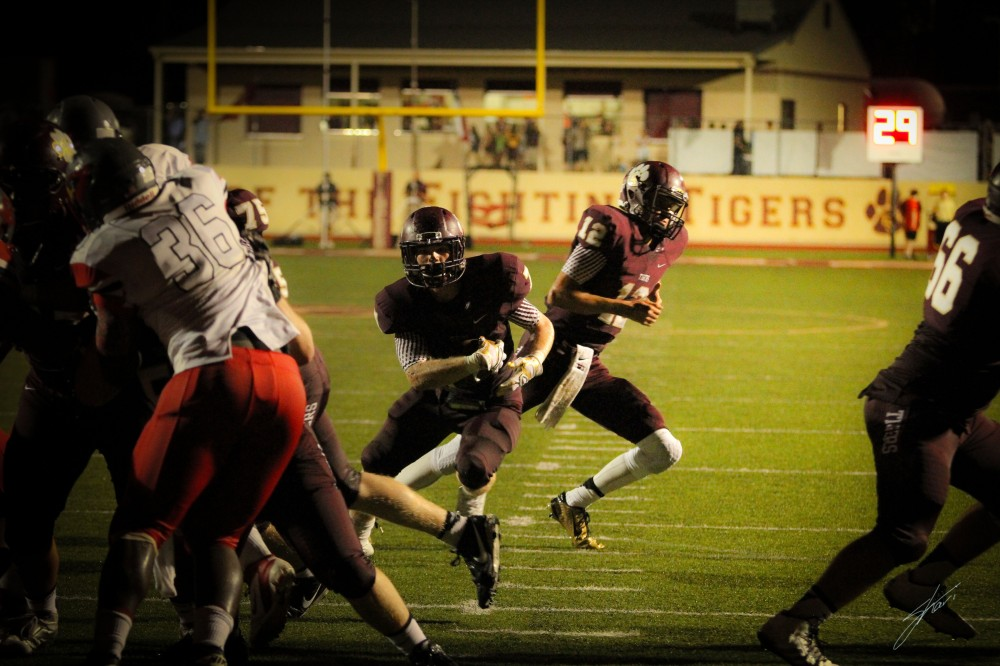 Running Back, Joe Fex (#7), looking for day light.