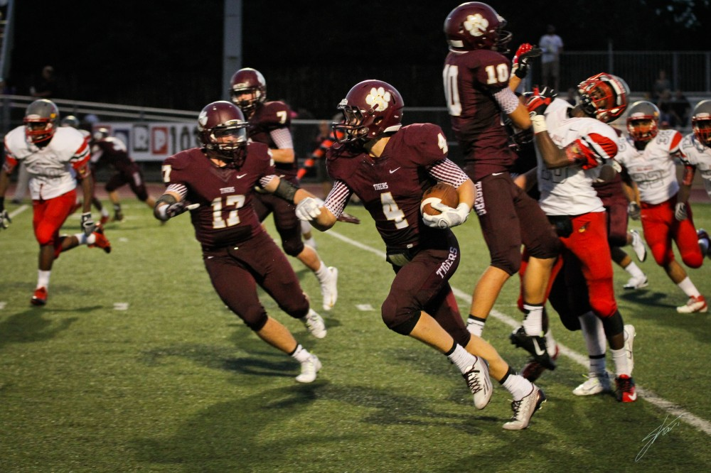 Ball carrier Reese Johnson, gets a good block from Kyle Houssian (#10).