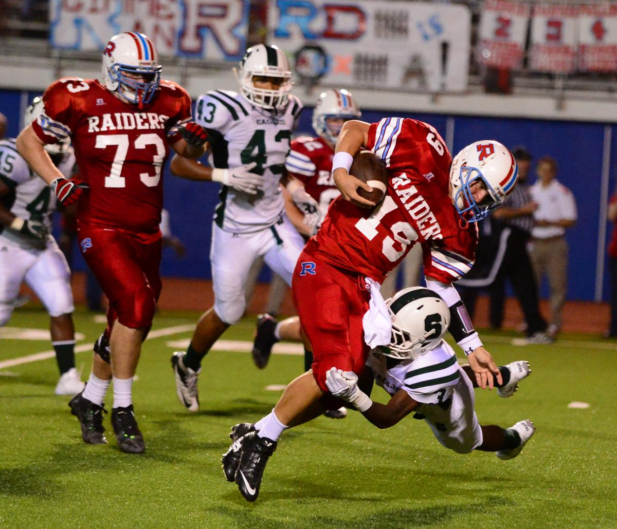 Archbishop Rummel (Metairie, La.) quarterback Chase Fourcade had his hand in six touchdowns in his team's 36-14 defeat of Archbishop Shaw (Marrero) on Saturday. Photo by Bill Arthurs.