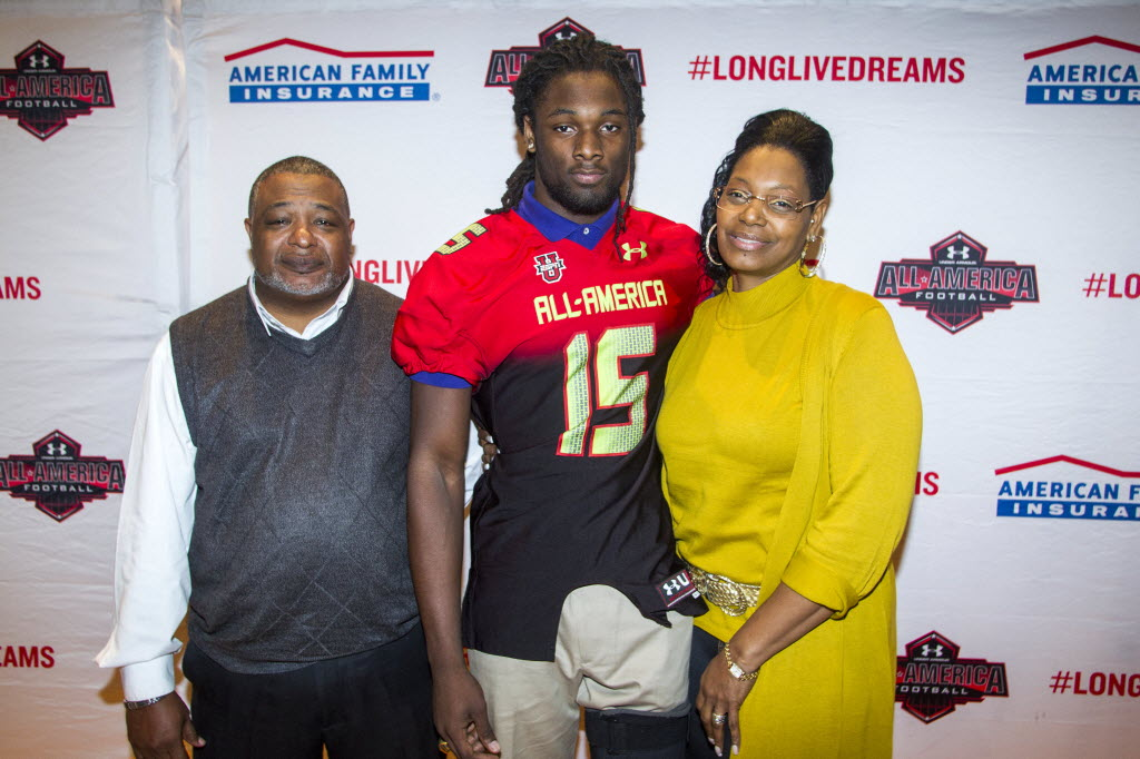 Josh Sweat with his parents William Washington and Carlette Sweat during a press conference to present Sweat with his All-American jersey.  Photo by Peter Casey/USA TODAY Sports Images