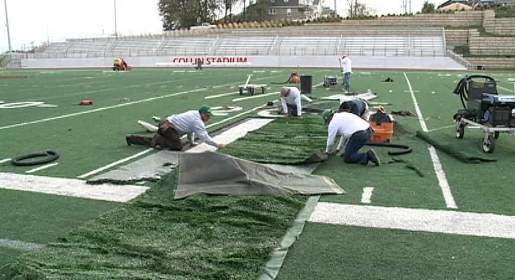Repair crews work on the Omaha South football field which was damaged by a teenage driver —Twitter