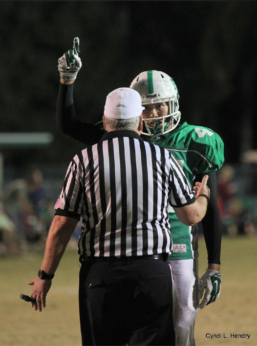 Sam Turner of Fort Myers (Fla.) High explains his gesture to an official. (Photo: Fort Myers New Press)
