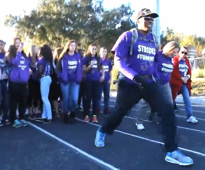 """Octavius """"Ocky"""" Clark is walking 250 miles to raise money for his high school's track and field facilities —Orlando Sentinel video screen shot"""