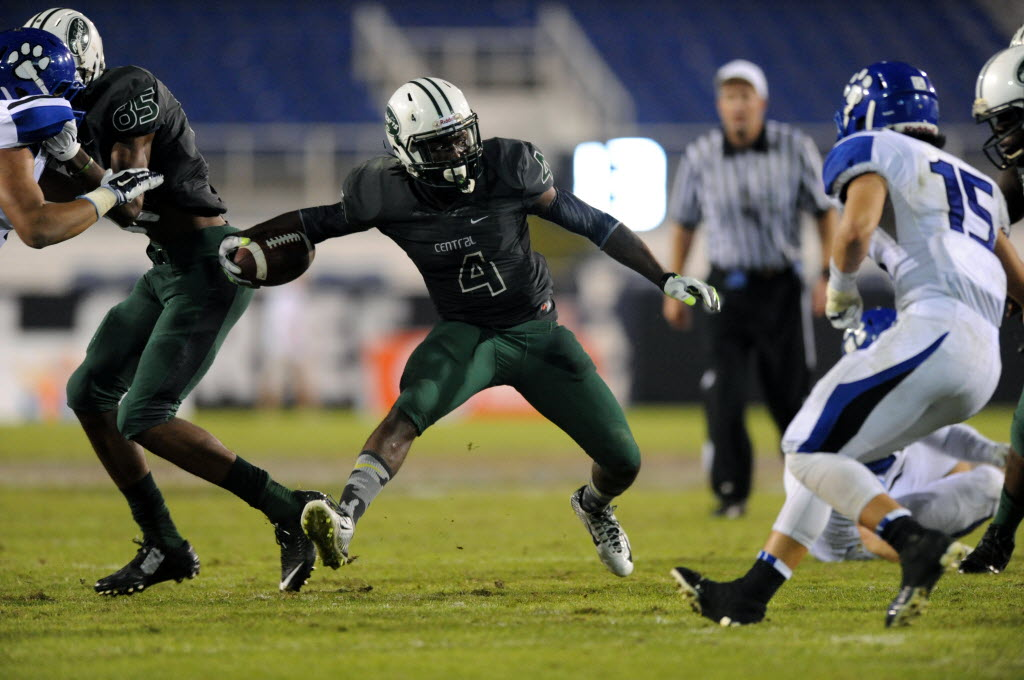Miami Central's Anthony Jones looks for running room against Bothell, Wash., Saturday in the Burger King State Champions Bowl Series in Boca Raton, Fla. Photo by Gary Curreri, South Florida Sun Sentinel.