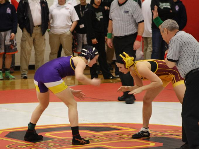 Puyallup wrestler Jordyn Bartelson (left) in a match at Steilacoom High School.
