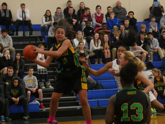Blanchet forward Jadyn Bush passes to guard Taylor Chambers after rebounding a missed Seattle Prep shot.