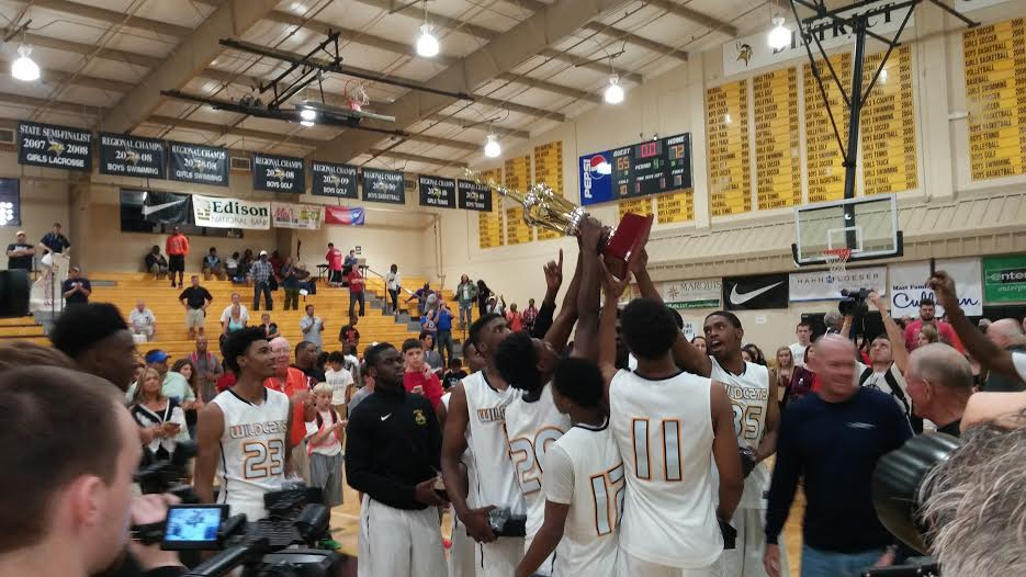 Wheeler celebrates after its 72-65 defeat of Montverde (Fla.) Academy in the City of Palms Classic championship Tuesday. Photo by Jim Halley