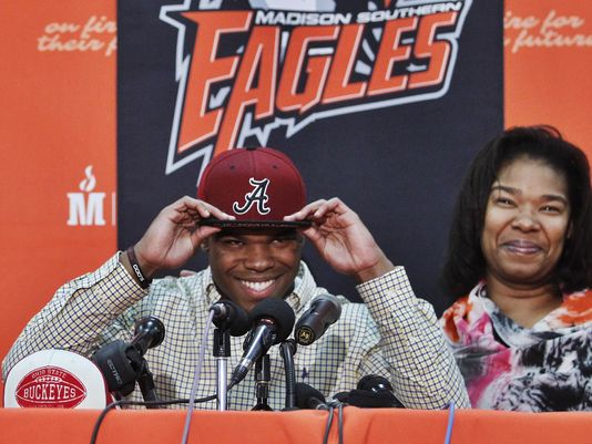 Damien Harris dons an Alabama hat as he announces his college choice (Louisville Courier Journal)