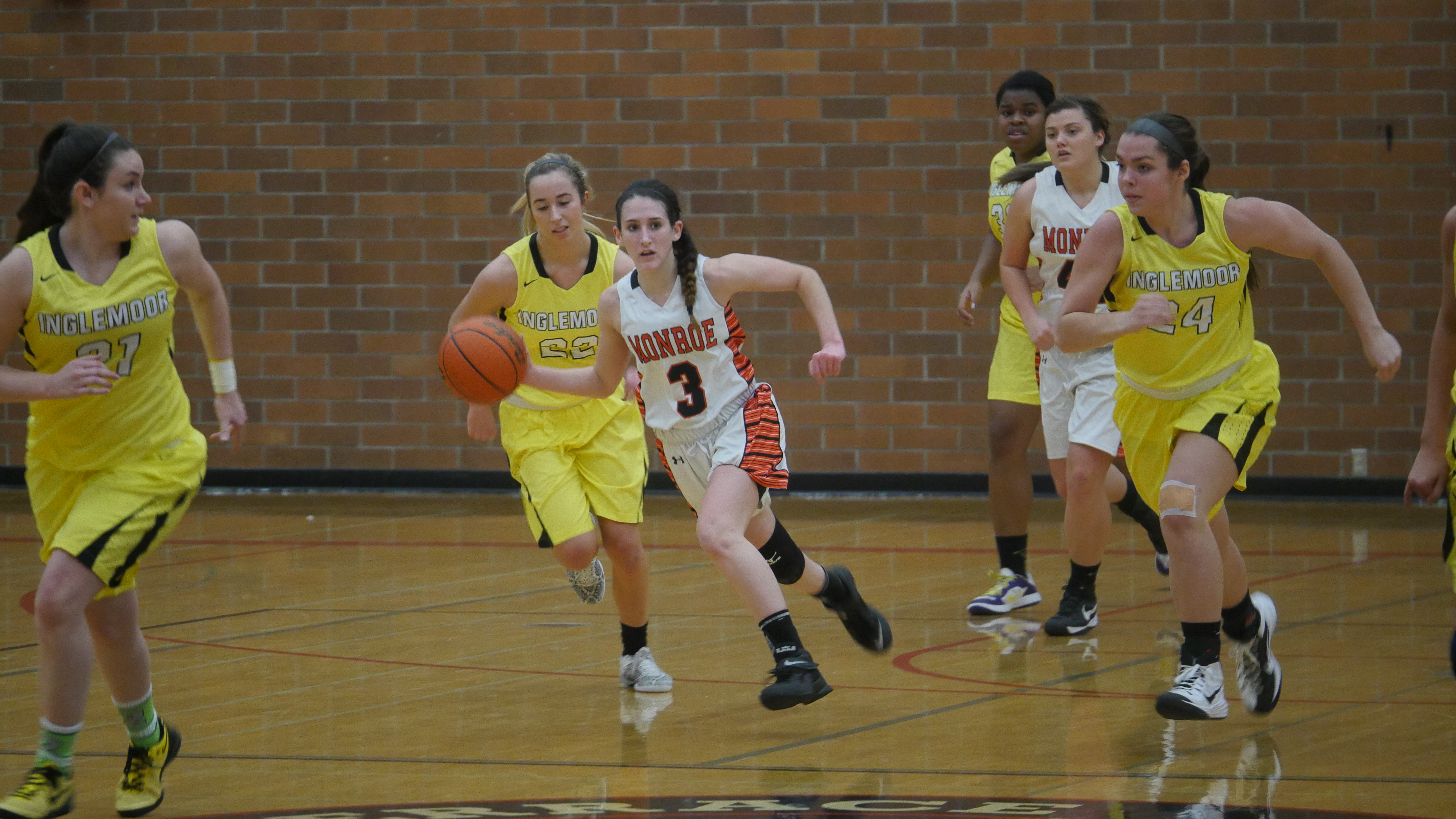 Monroe's Kylee Ferreira leads a fast break during the tournament game against Inglemoor.