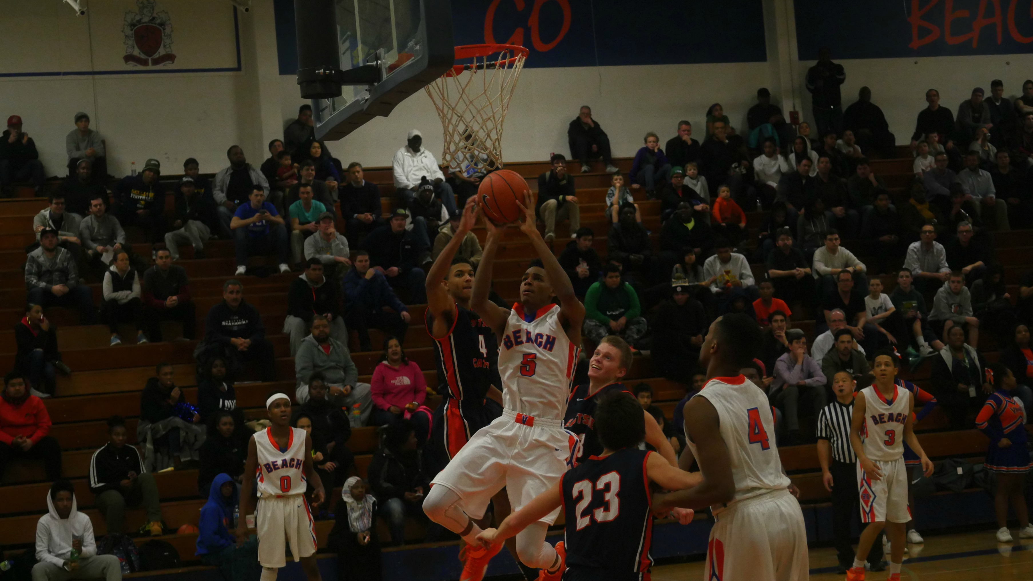 Rainier Beach guard Dejounte Murray puts up a shot over Eastisde Catholic's Matisse Thybulle.