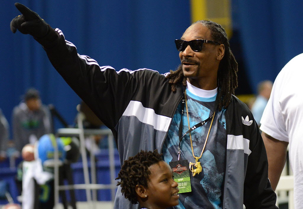 Rapper Snoop Dogg waves to fans at the Under Armour All-American High School Football Game Friday in St. Petersburg, Fla. His son, Cordell Broadus, was playing in the game. Photo by Jonathan Dyer, USA TODAY Sports
