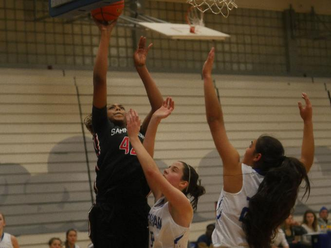 Sammamish center Promise Taylor goes for a layup.