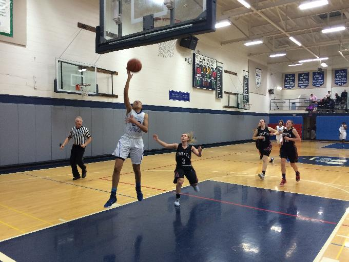 Martina McCowan goes up for a fast break layup in the second quarter against Tualatin.