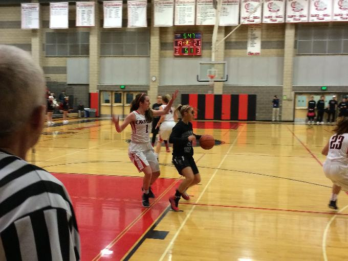 Oregon City's Lindsi Peters sets up a backdoor pass in the second quarter against Clackamas.