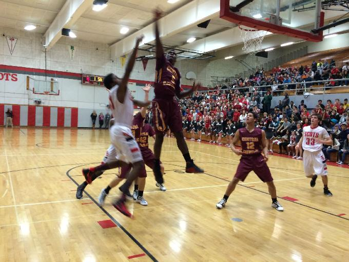 Central Catholic's LaMar Winston goes up high for the block against David Douglas.