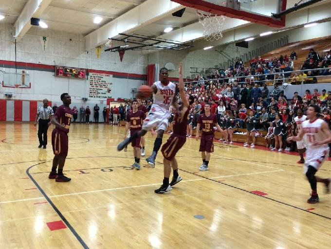 David Douglas' Dwight Dew soars through the middle of the key against Central Catholic.