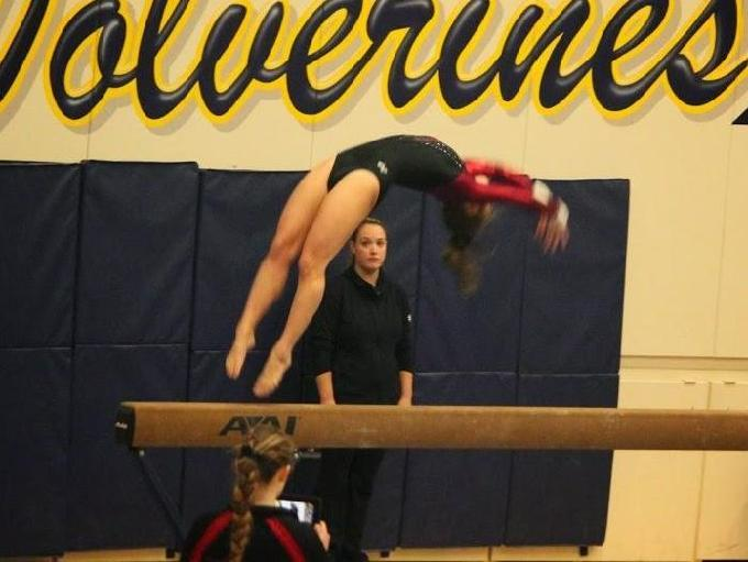 Sammamish gymnast Nykaela Dodson does her balance beam routine in a meet against Bellevue. Photo by Catherine Smith.