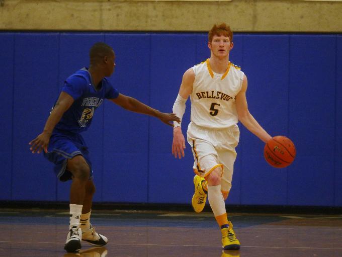 Bellevue guard Kyle Foreman dribbles down the court.