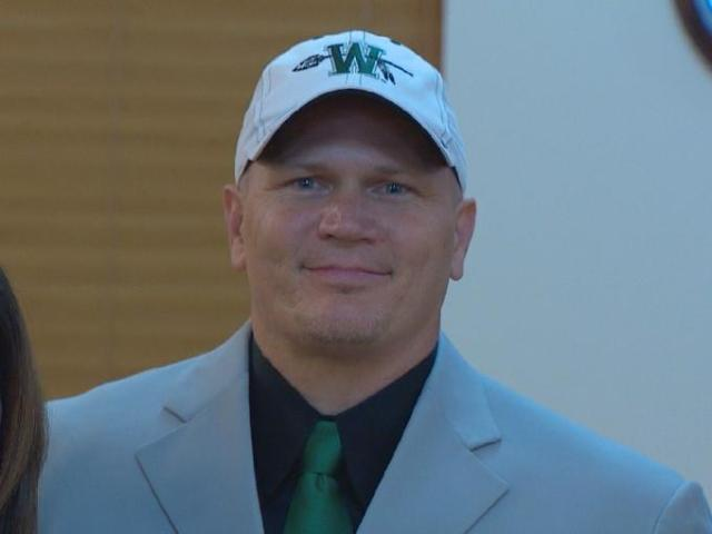 Former Cowboys QB Jon Kitna is introduced as the new head football coach at Waxahachie.