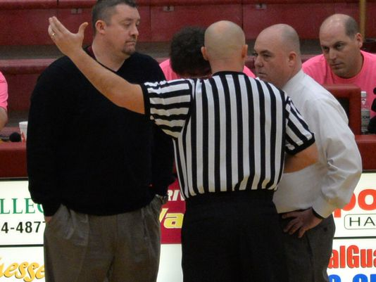A referee talks to Riverdale coach Cory Barrett, left, and Smyrna coach Shawn Middleton during the Lady Bulldogs win over Riverdale on Saturday. (Photo: Steve Hardison, Daily News Journal)