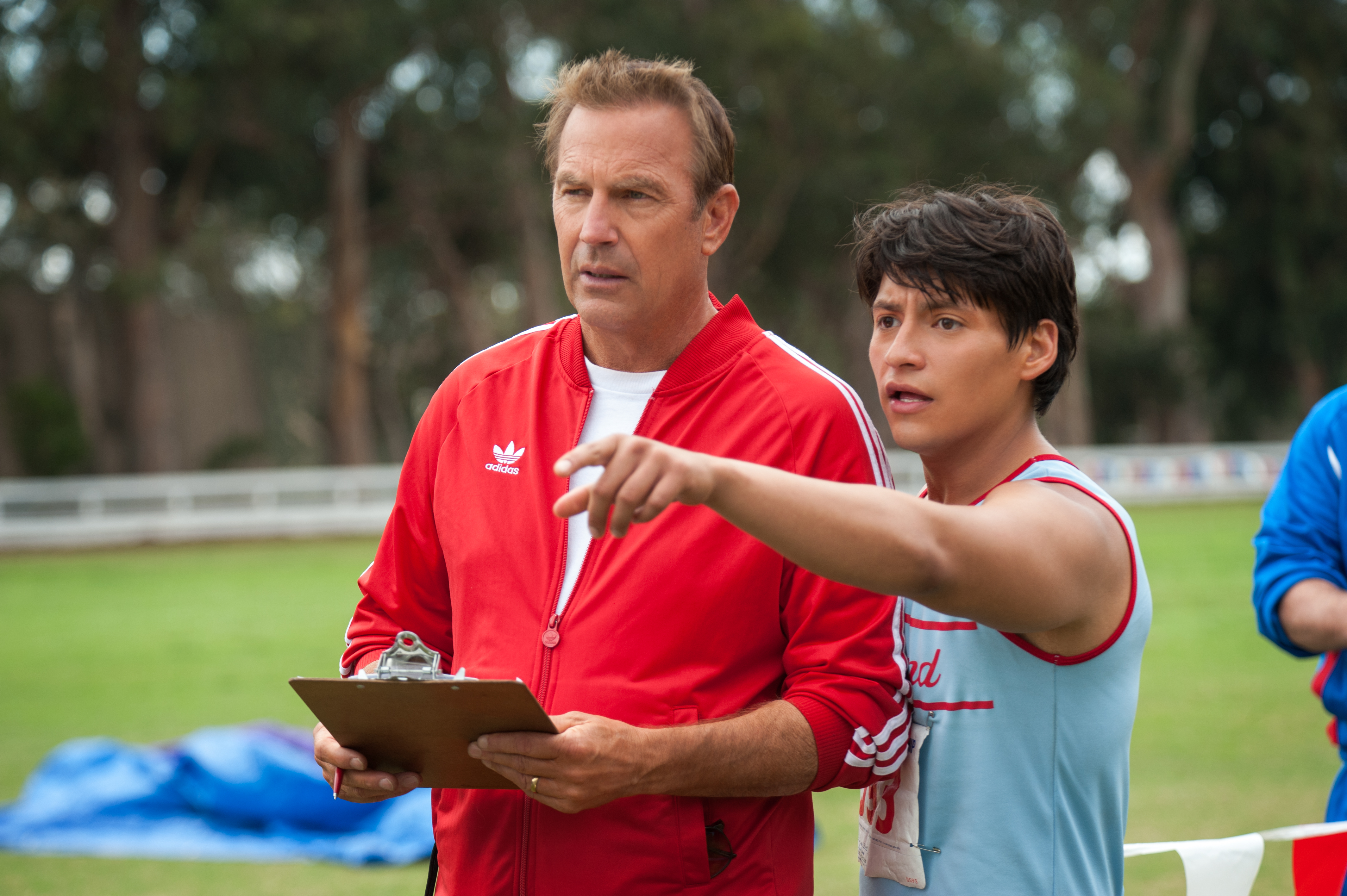 Kevin Costner, foreground left, and Carlos Pratts appear in a scene from McFarland, USA. (Photo: Disney Pictures)