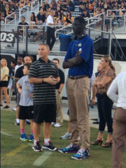 Tacko Fall with head coach Donnie Jones at the UCF's football game against BYU. (Photo: FILE PHOTO)