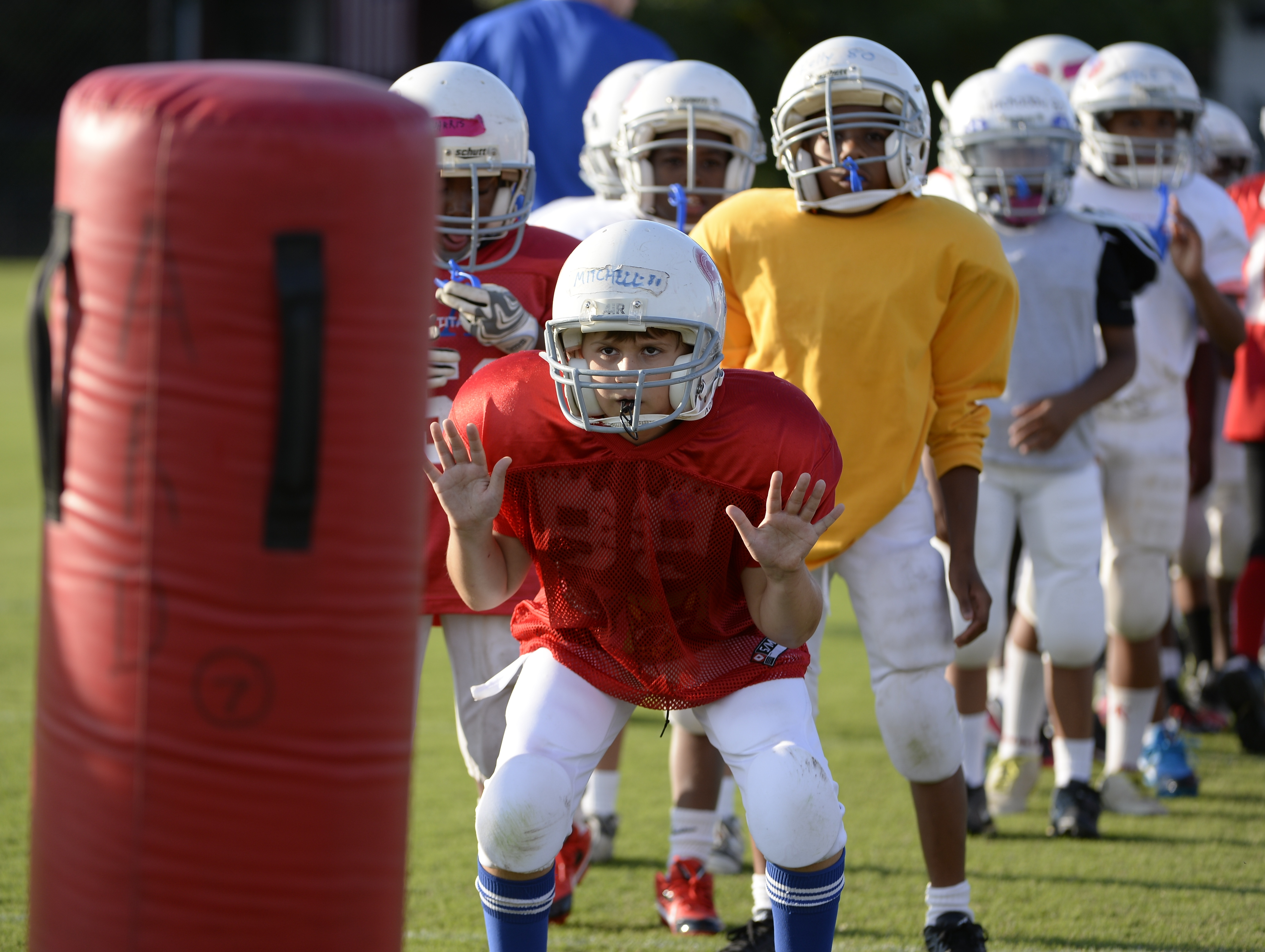 Mason Mitchell, 9, participates in a Heads Up Football drill during Fairfax County Youth Football practice in Virginia (Photo: H. Darr Beiser, USA TODAY)