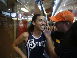 Suffern's Kamryn McIntosh is congratulated by her coach Jeff Dempsey after she broke the national record for the 600 meters during the Section I class AA and C championships at the Armory in Manhattan on Feb. 17, 2015. (Photo: Ricky Flores/The Journal News)