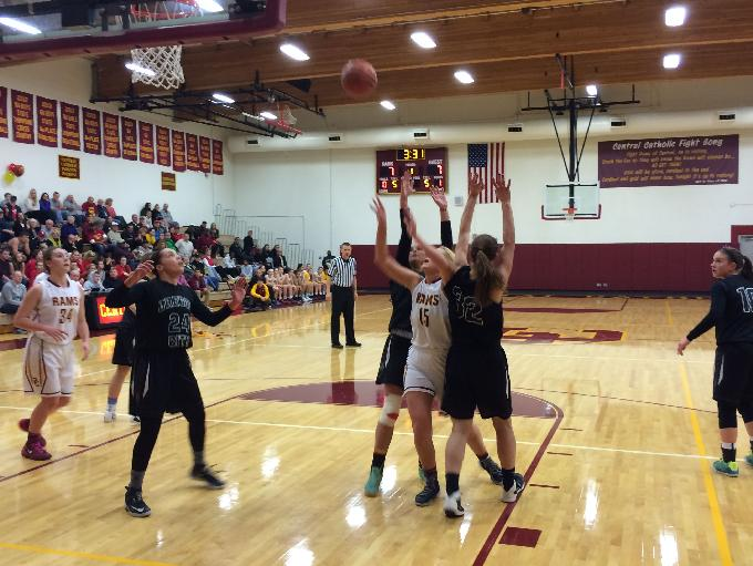 Oregon City's Katie Kammerer and Taylor Shaw contest Central Catholic's Jerusha Paine's shot.